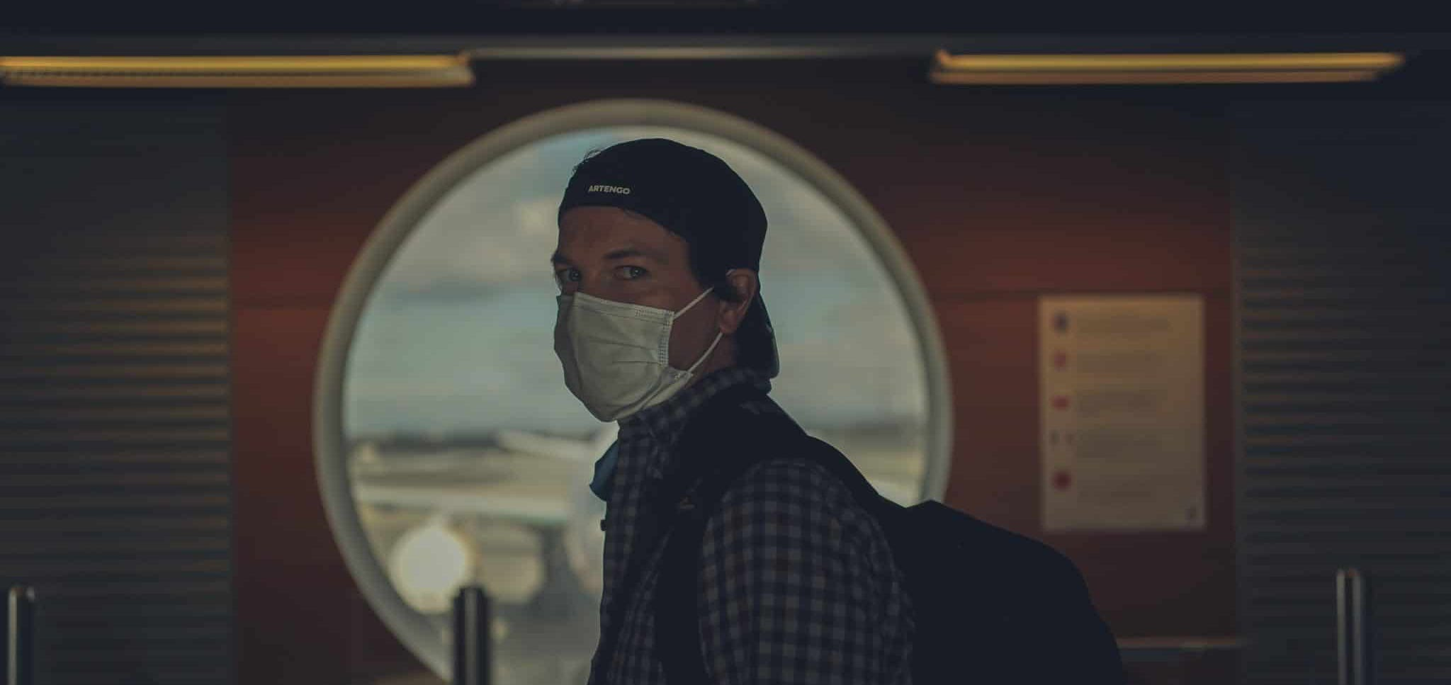 traveller wearing a mask at an airport