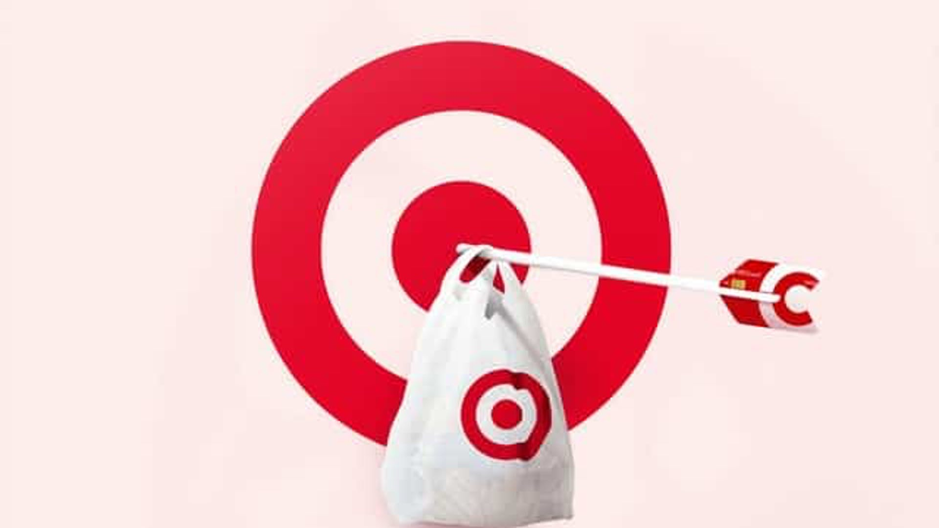 An arrow holding a carrier bag in the centre of a target