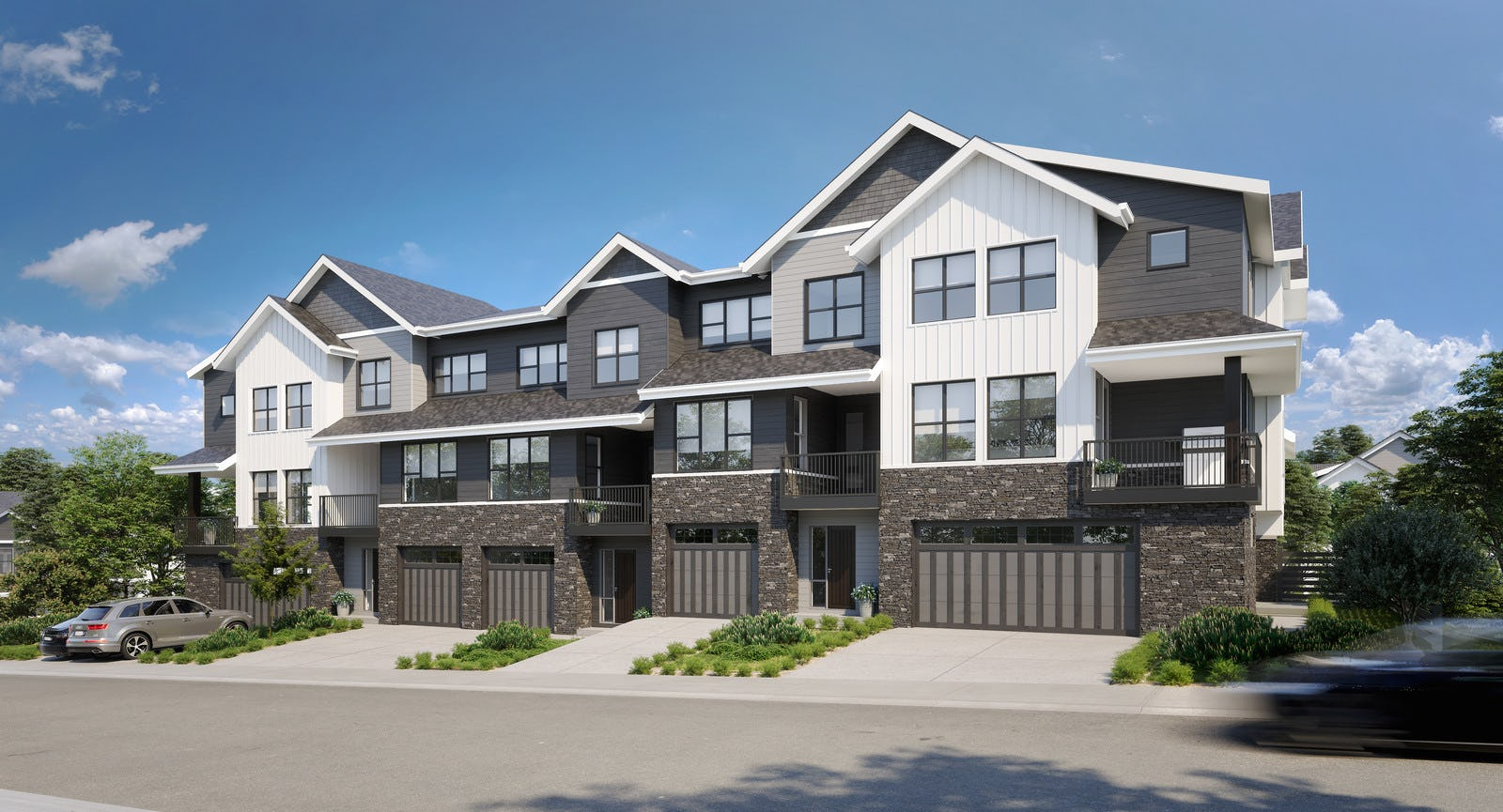Grey and white townhomes with garage