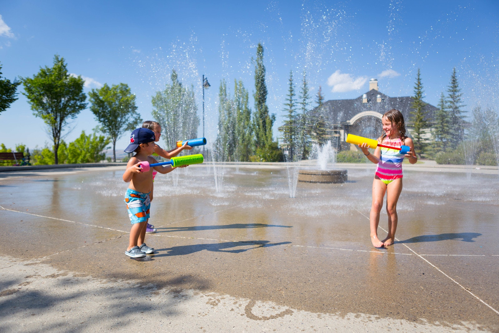 Children playing in a spray park on a summer day