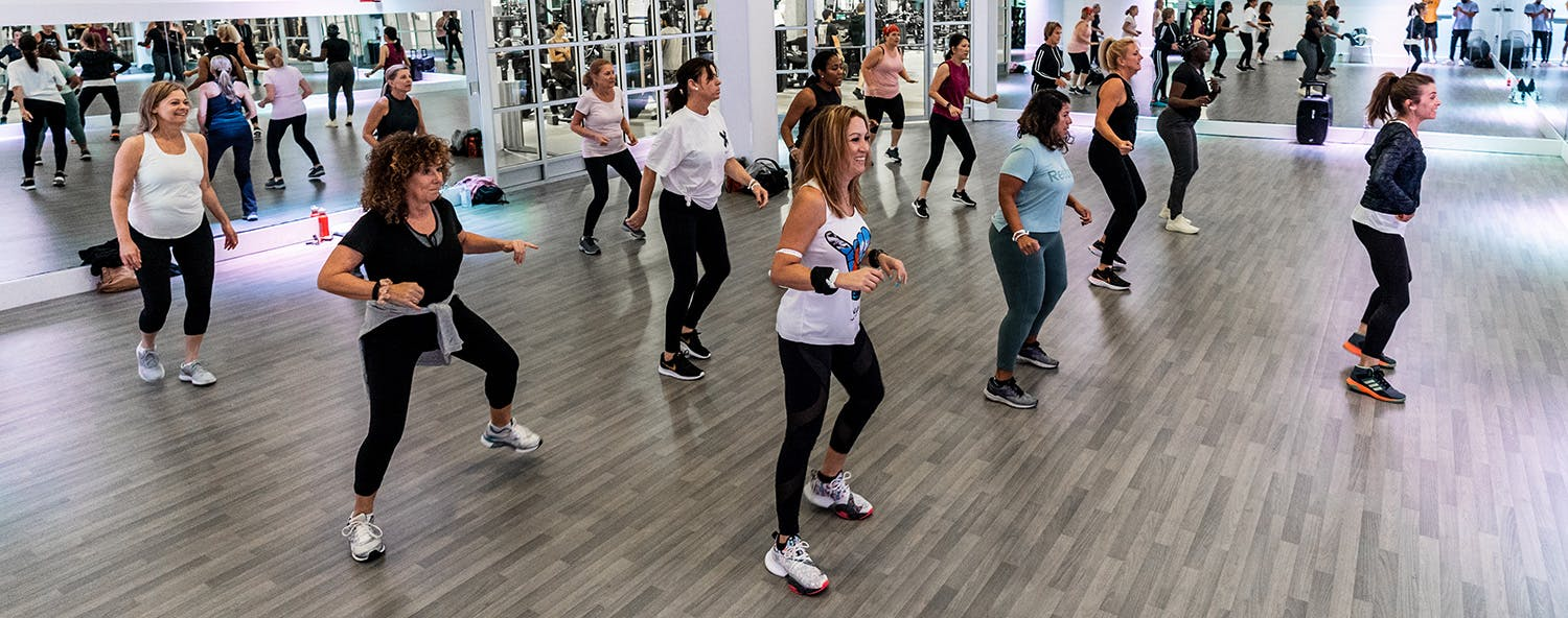 Members participating in a to the rhythm dance class in the studio