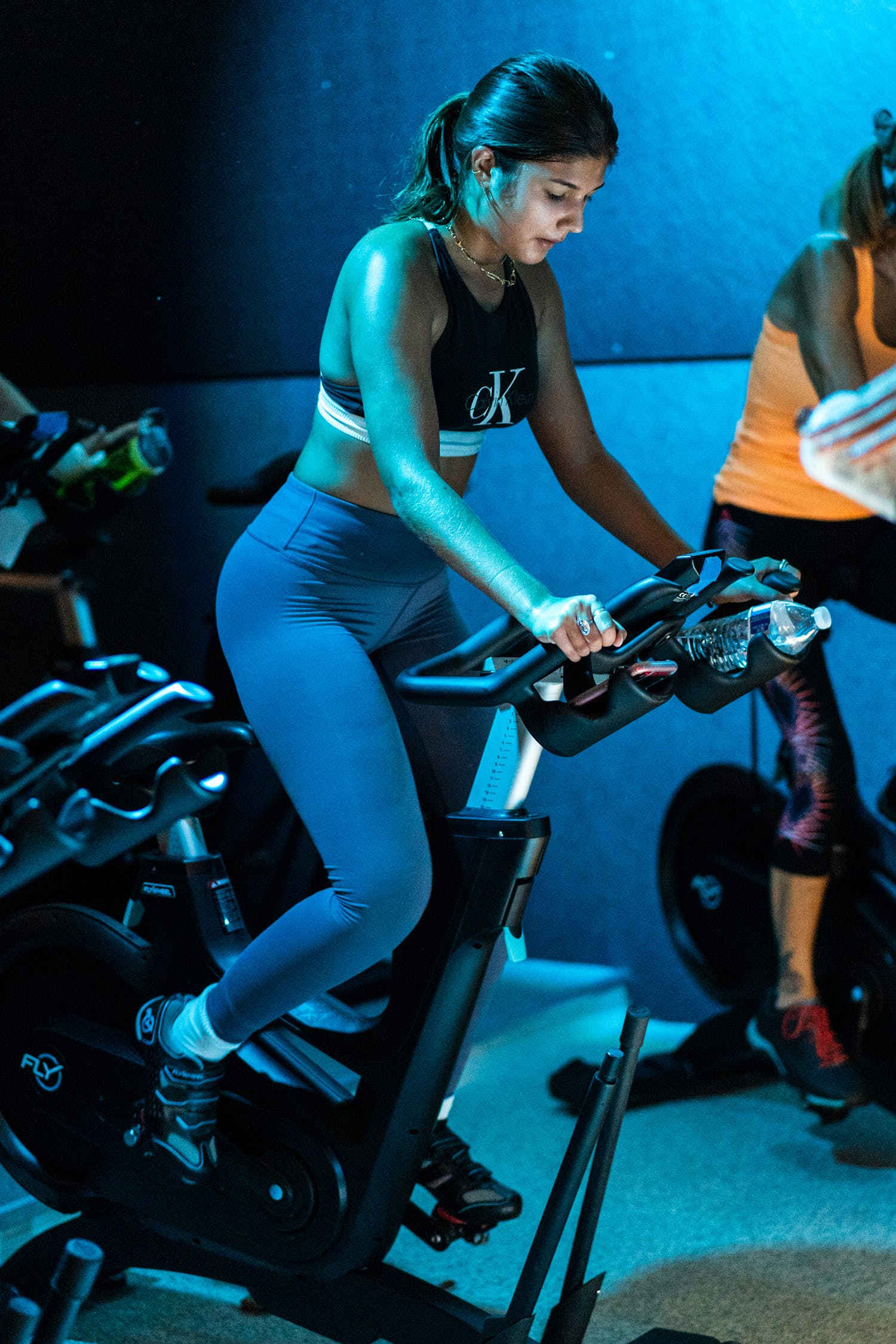 Blue light shining on cycle and pump class