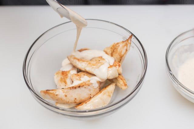 white bbq sauce spooned over chicken breast