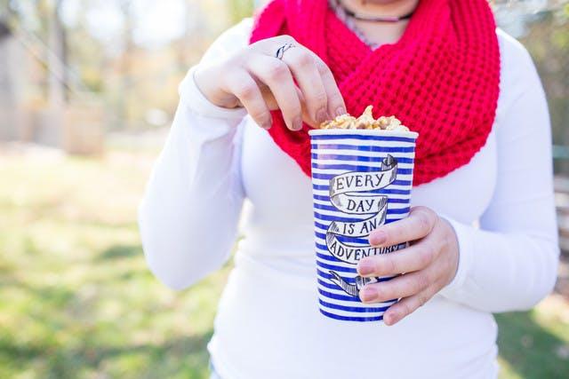 Woman eating caramel popcorn