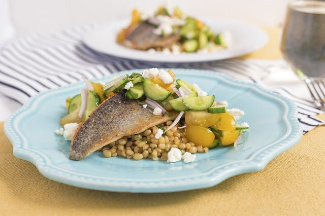 trout with sun gold tomatoes and wheat berries