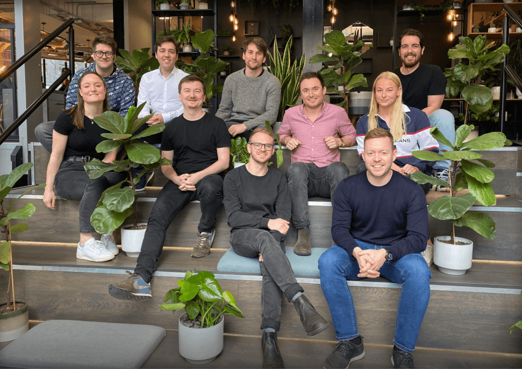 The Penfold team sitting amongst lots of plants