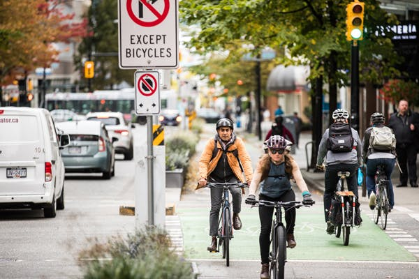 Commuters biking in bike lanes.