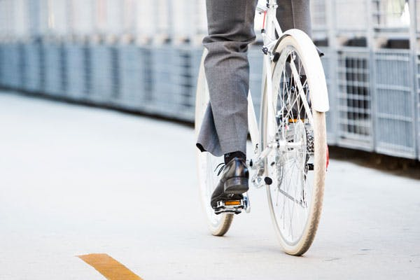 A worker commutes to work by bike.