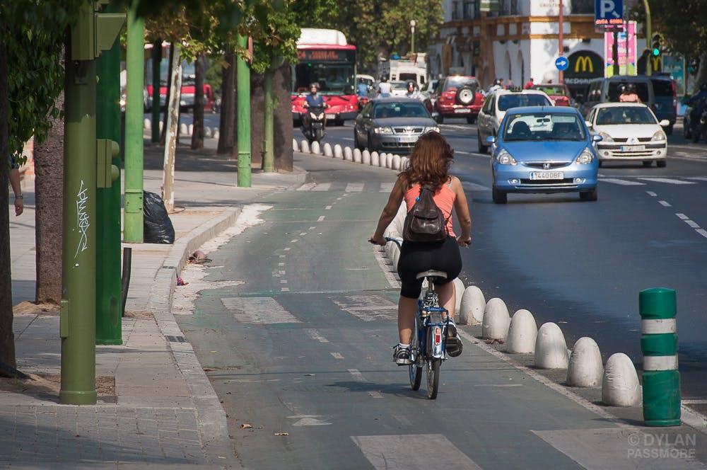 Biker using a dedicated bike lane in Sevilla.
