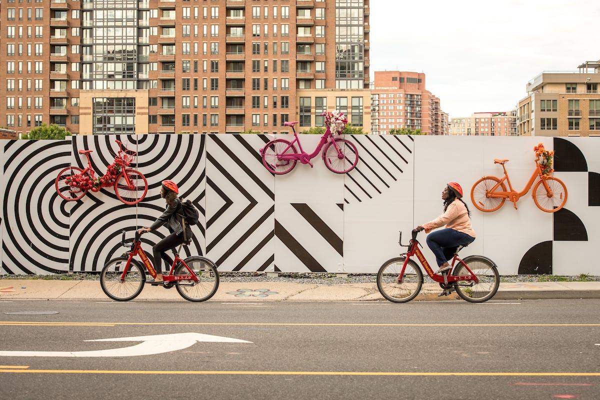 Two bikers use Capitol Bike Share in Arlington, Virginia. (Photo credit: Sam Kittner/Kittner.com, courtesy of Arlington County Commuter Services.)