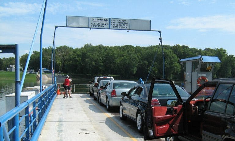 Bike riders cross the Potomac River on White's Ferry.