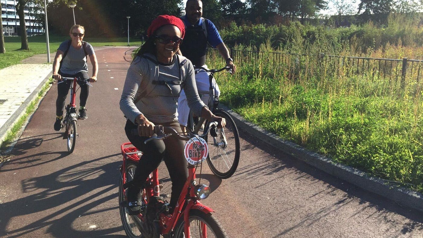 Roshun Austin, who first learned to bicycle at age 44, rides as part of a bike study tour in Amsterdam.