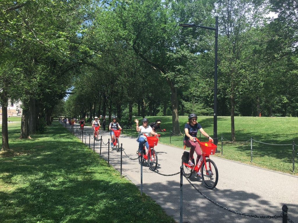 Fly-in participants cruise the National Mall on JUMP e-bikes.