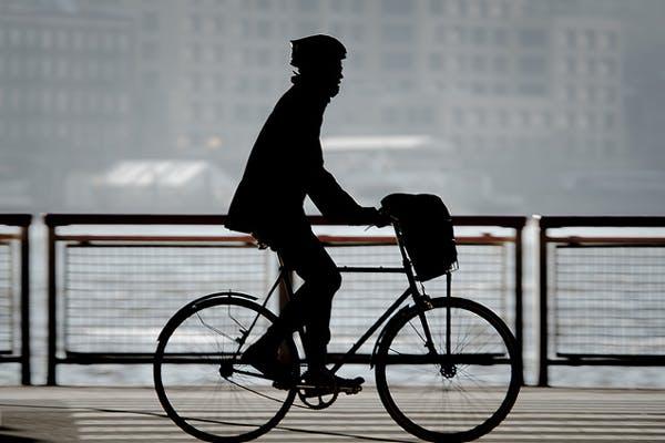 A rider in silhouette.