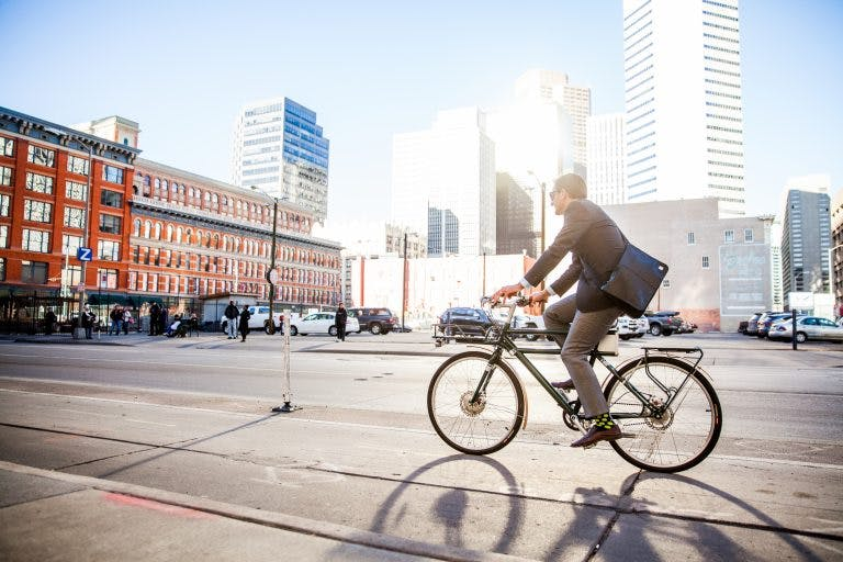 A worker commutes on an e-bike.