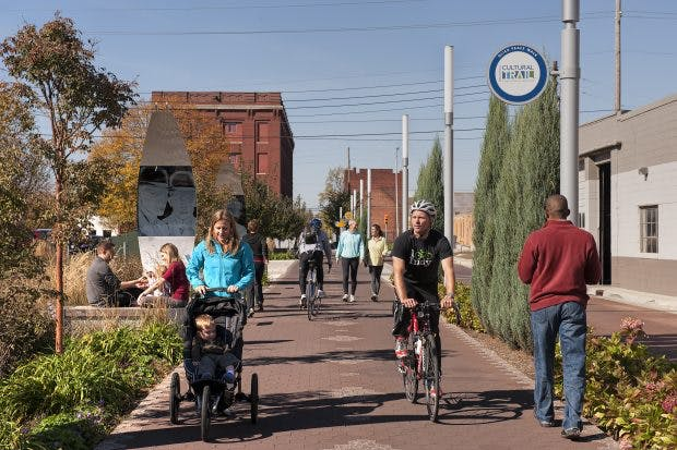 Pedestrians and bikers on the Indianapolis Cultural Trail.