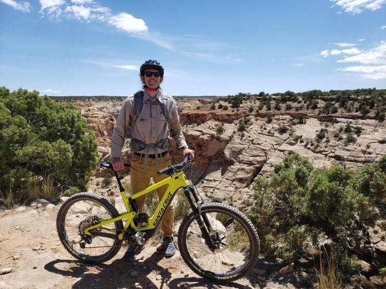 Blake Baker, an Outdoor Recreation Planner at the Bureau of Land Management's Price Field Office in Utah, with an electric mountain bike.
