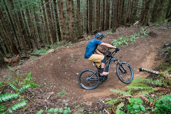 Riding an electric mountain bike.