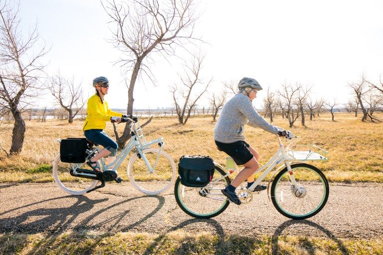 Electric bikes make long-distance tours accessible to a broader audience.