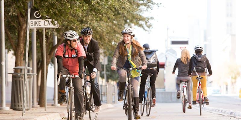 Bikers in a bike lane.