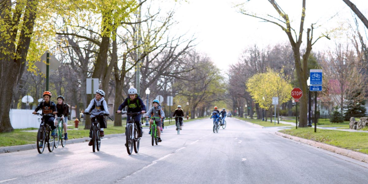 Kids riding down the street, Source: Norte, Beth Price.