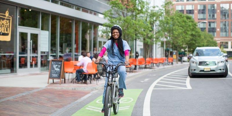 Medical professional using a bike lane to get around town
