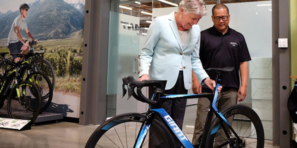 Representative Julia Brownley (D-CA-26) checks out the Giant Propel Advanced SL Disc at Giant's U.S. headquarters in Newbury Park, California.