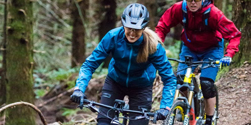 E-Bike riders in forest setting