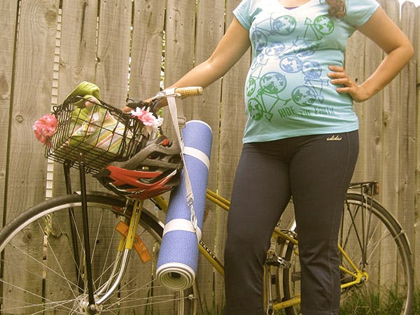Pregnant woman on bicycle