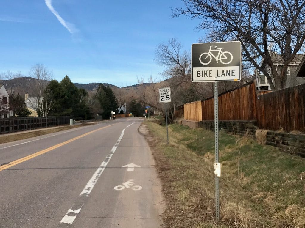 Bike lane and speed limit sign