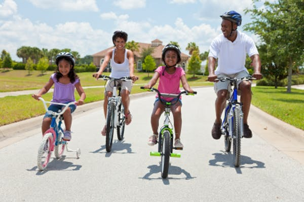 A family takes a bike ride together.
