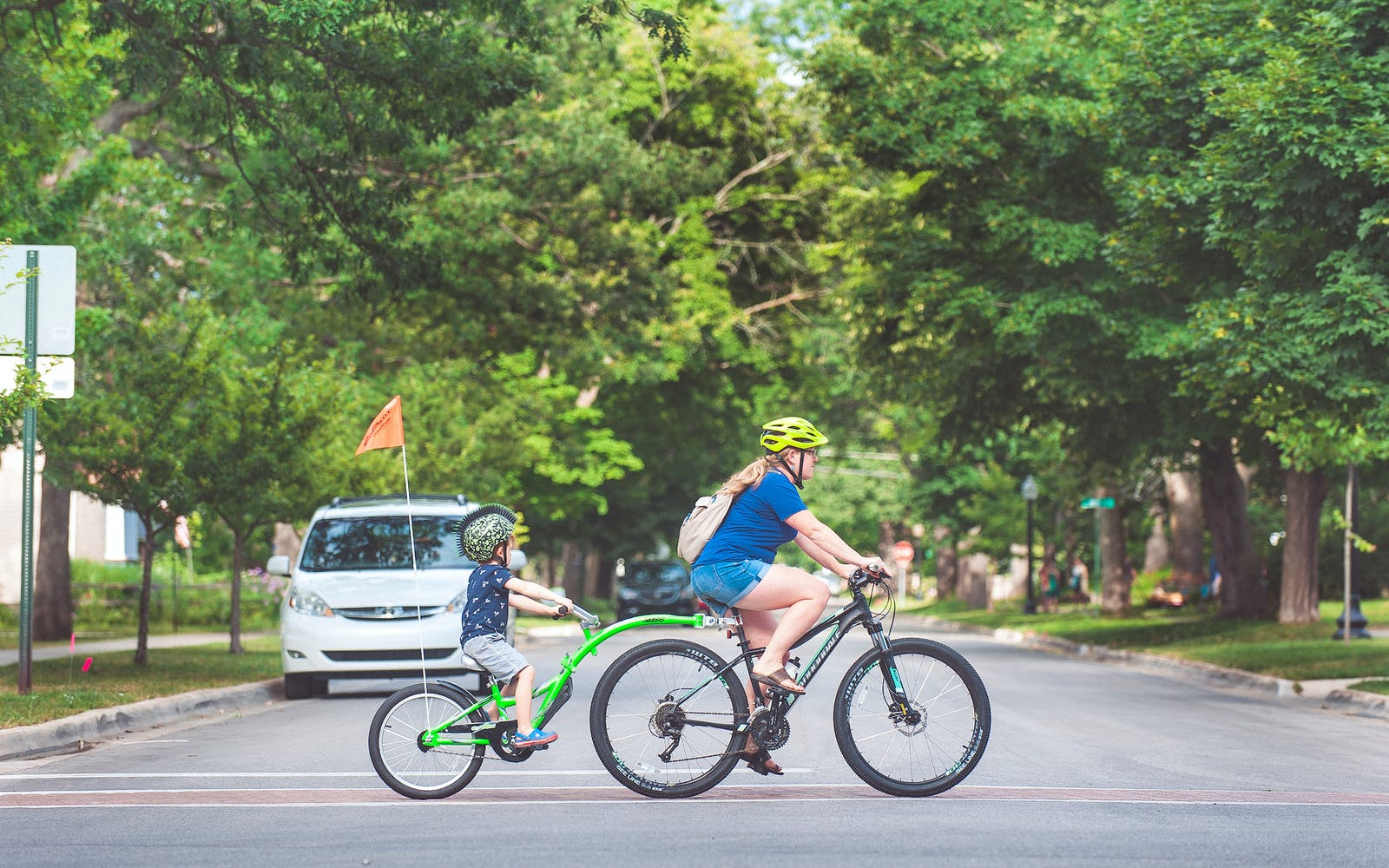 A female bicyclist and child in Traverse City, Michigan. Photo by Gary Howe.