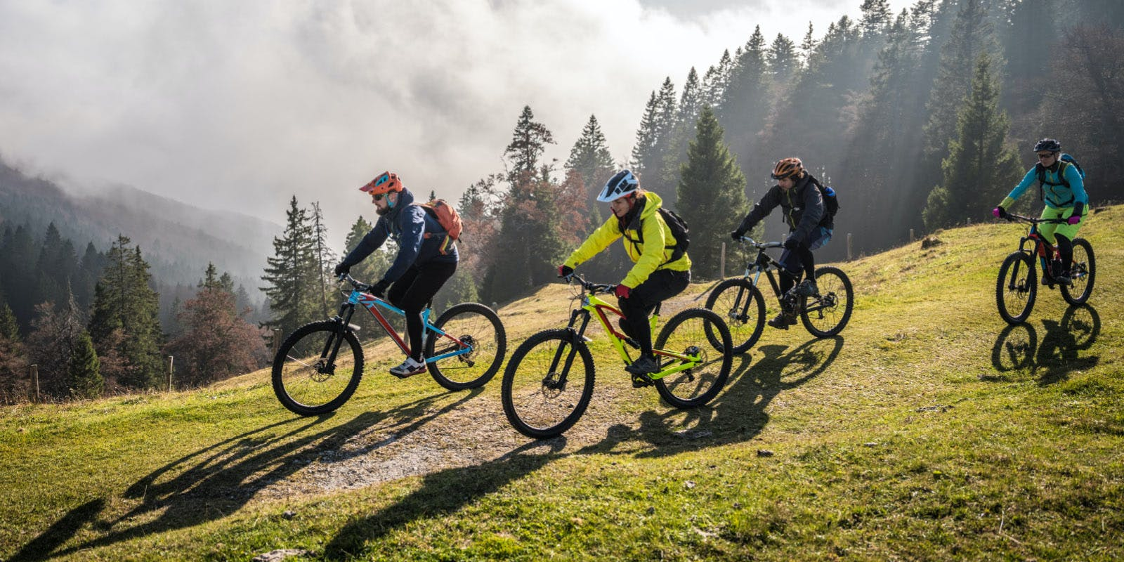 Mountain bikers in the foggy highlands