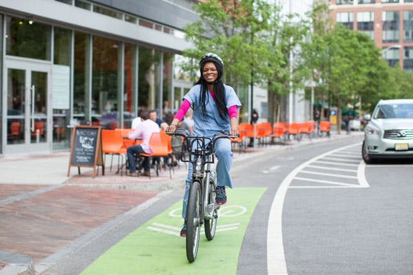 A doctor commutes to work by bicycle.