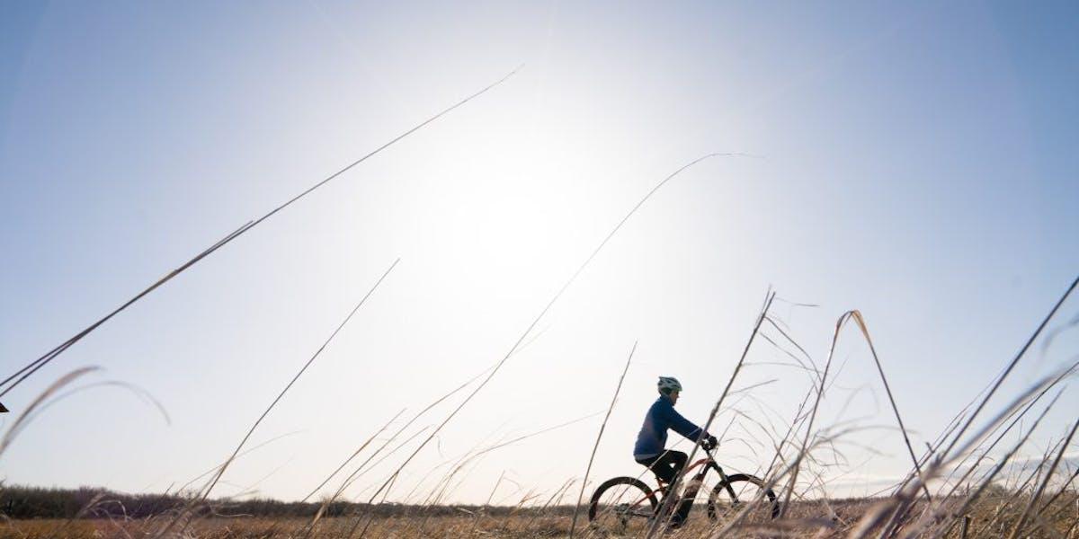 E-biker going across a field