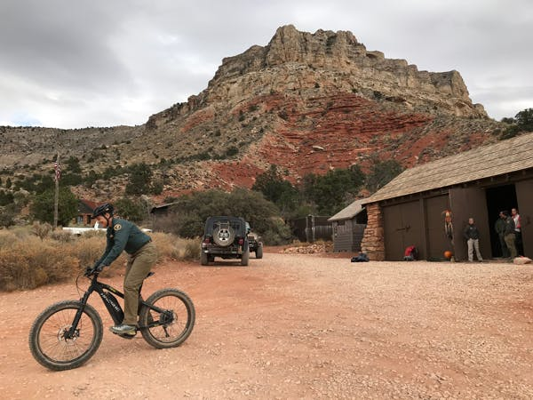 Todd Seliga, backcountry ranger for the Tuweep area of Grand Canyon National Park, tries out a eMTB.