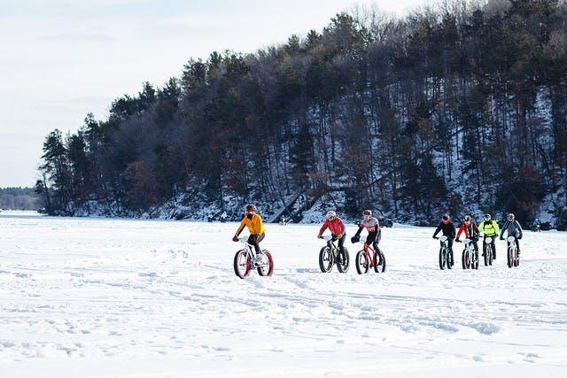Bikers enjoy a snowy ride.