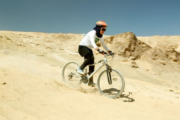 A woman rides in the Hindukush MTB Challenge.