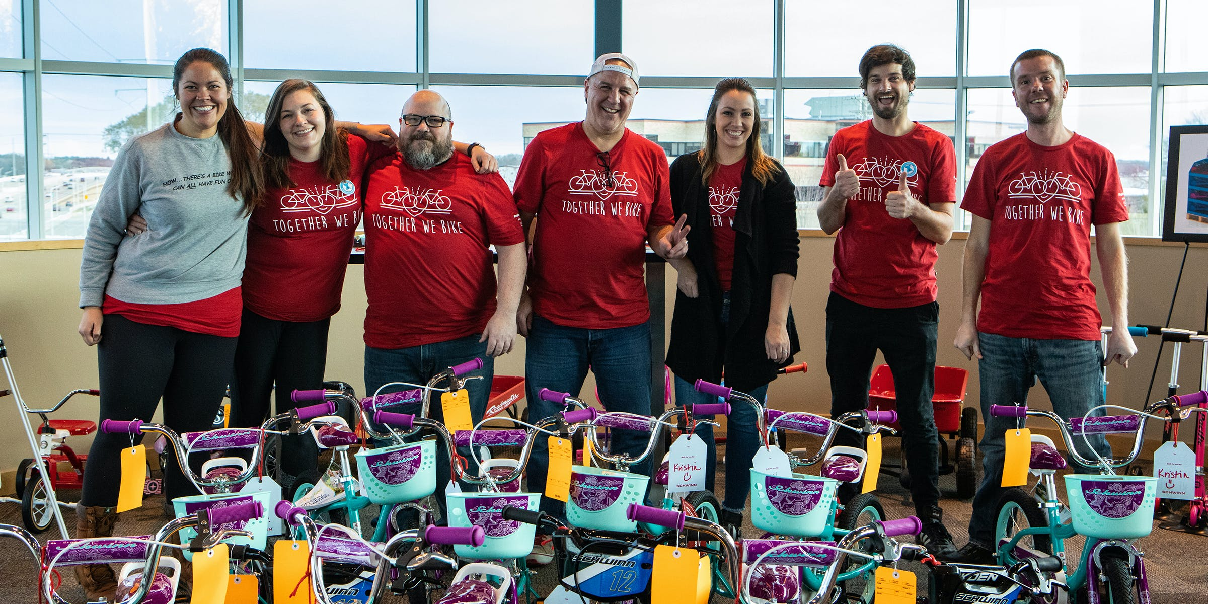 Members of the non-profit Together We Rise with donated bicycles.