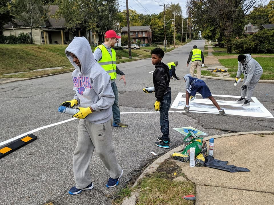 Painting a bike lane in Memphis.