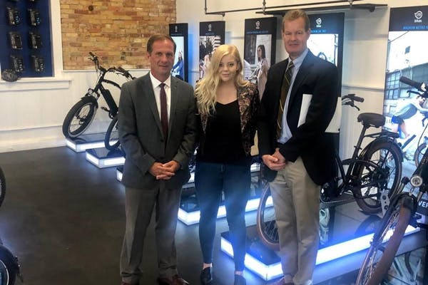 (Left to right) Congressman Chris Stewart (UT-02) with Skye Willard, Director of BPM at Magnum Bikes, and Gary Webster, the Congressman's Division Director.