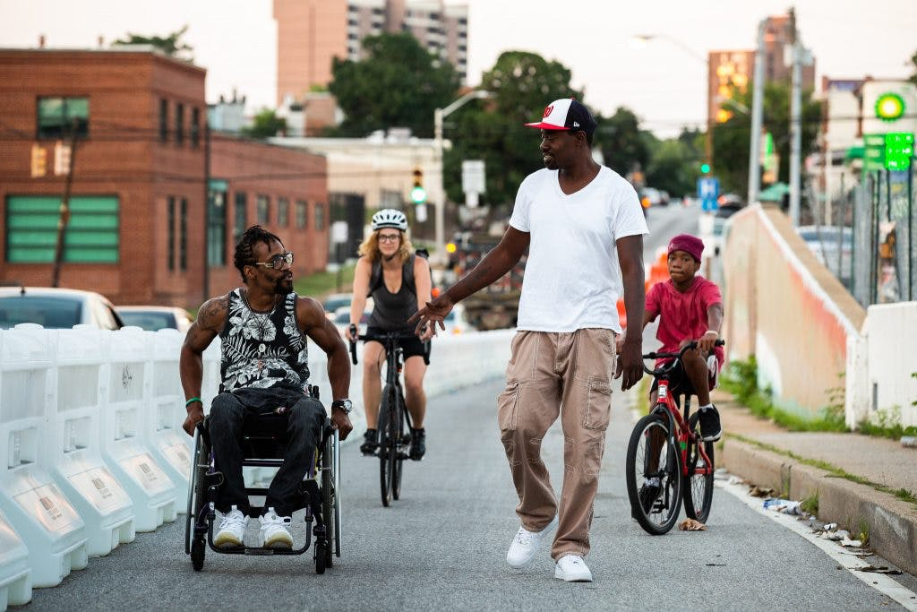 The new protected pathway opened access to the 28th Street bridge for pedestrians in wheelchairs.