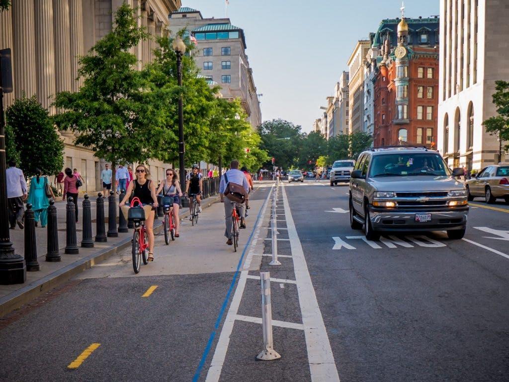 Bike riders enjoy a protected lane in Washington, D.C.