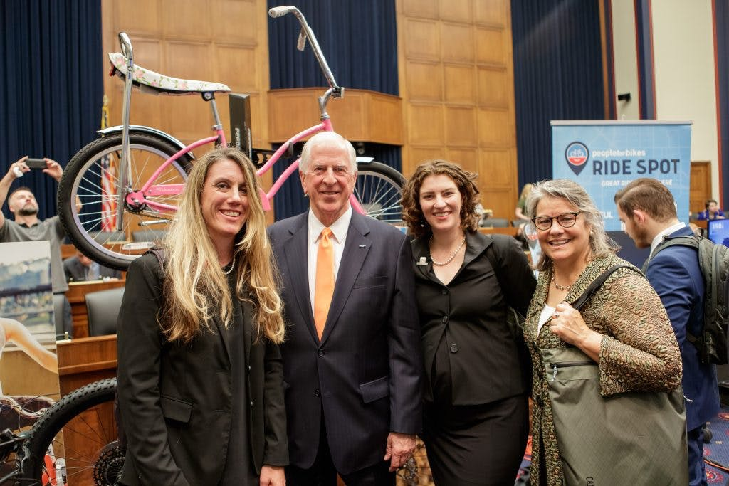 Camelbak's Jamie Lynn Furrer (left) and Kelsey Hammond (second from right) pose with Rep. Mike Thompson (D-CA) during the Congressional Bike Fest. Furrer and Hammond also met with Thompson's office during their day of meetings.