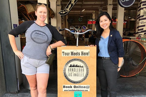 (Right to left) Jade Suh, field staff for Senator Dianne Feinstein (CA) poses with Founder and Owner of Handlebar Bike Tours LA, Jennifer Nutting