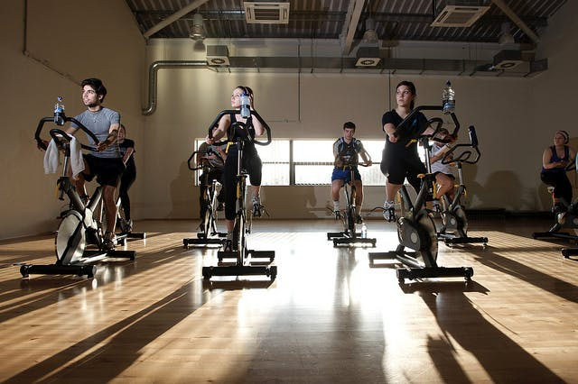 Indoor biking classes are a great way to keep cycling in the winter months.
