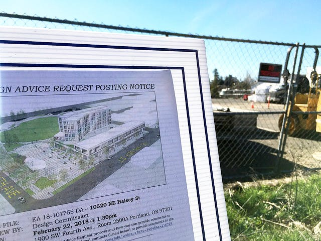 A public meeting announcement posted at the future site of Gateway Discovery Park.