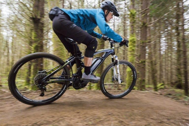 Riding an electric mountain bike.