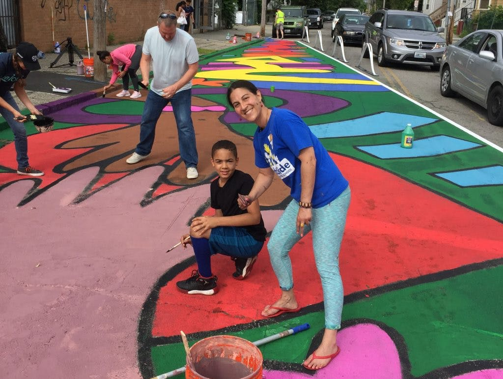 Community members picked up brushes and joined the efforts to paint murals to help show where prospective bike lanes would be built.