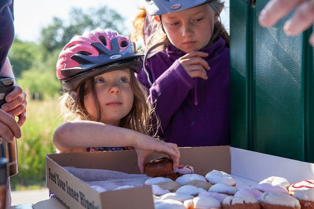 Girl samples donuts in Fort Collins